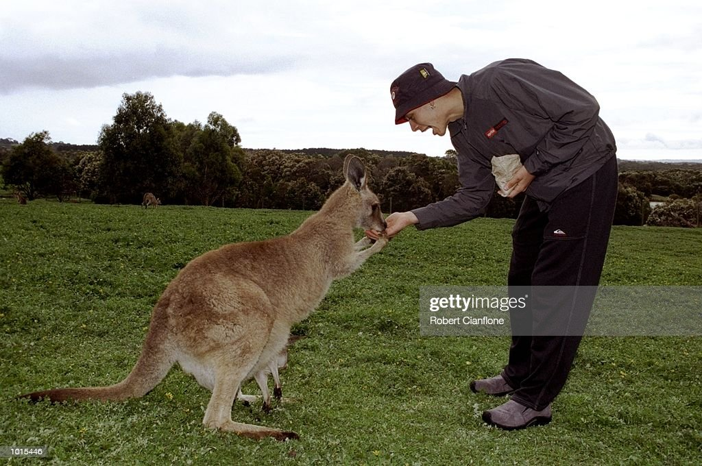 Valentino Rossi of Italy feeds a kangaroo before the Australian Motorbike Grand Prix held at Phillip Island in Victoria, Australia. \ Mandatory Credit: Robert Cianflone /Allsport