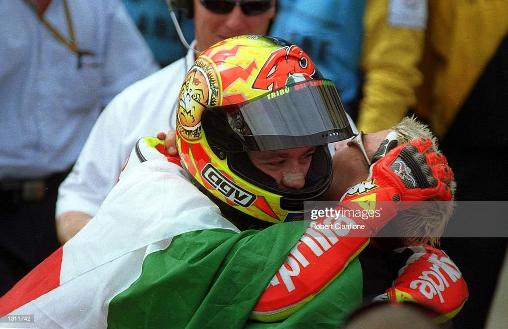 Valentino Rossi #46 of Italy hugs fellow Italian and 125cc winner Marco Melandri following Rossi's victory in the 250cc race at the 1999 Australian Motorbike Grand Prix at Phillip Island, Victoria, Australia. Mandatory Credit: Robert Cianflone/ALLSPORT