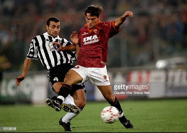 Vincenzo Montella of Roma holds off Paolo Montero of Juventus during the Seria A match at the Stadio Olimpico in Rome Italy Juventus won 10 Mandatory...