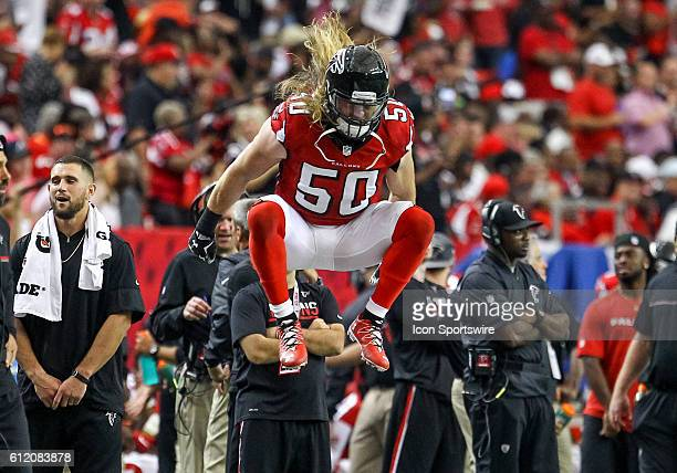 Atlanta Falcons defensive end Brooks Reed gets warmed up before the start of the fourth quarter of the NFL game between the Carolina Panthers and the...