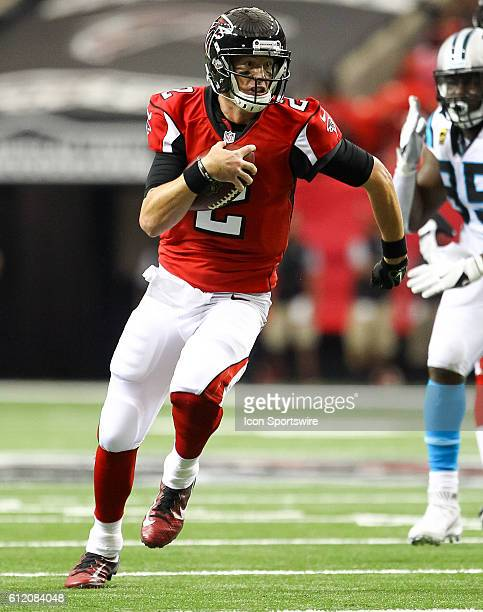Atlanta Falcons quarterback Matt Ryan runs the ball during the first quarter of the NFL game between the Carolina Panthers and the Atlanta Falcons...