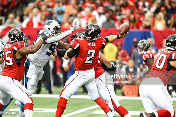 Atlanta Falcons quarterback Matt Ryan throws the ball under pressure during the first half of the NFL game between the Carolina Panthers and the...