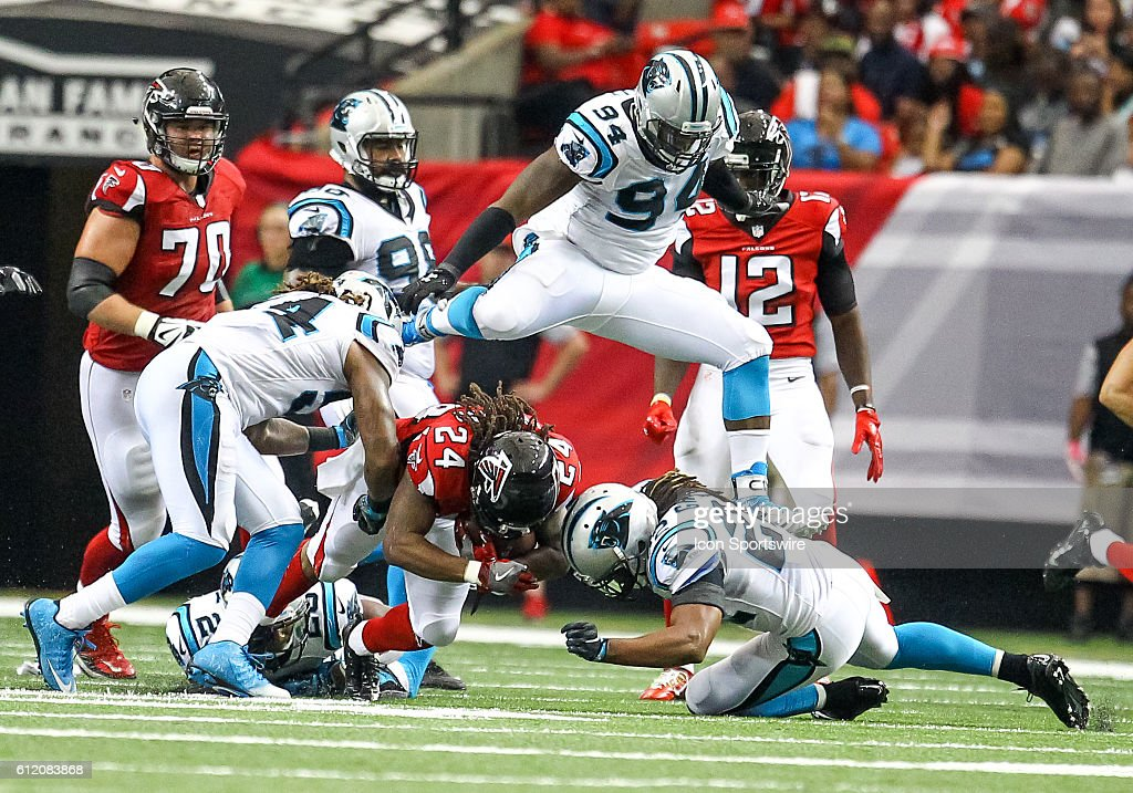 Atlanta Falcons running back Devonta Freeman (24) in action during the fourth quarter of the NFL game between the Carolina Panthers and the Atlanta Falcons. The Falcons beat the Panthers 48 - 33 at the Georgia Dome in Atlanta, Georgia.