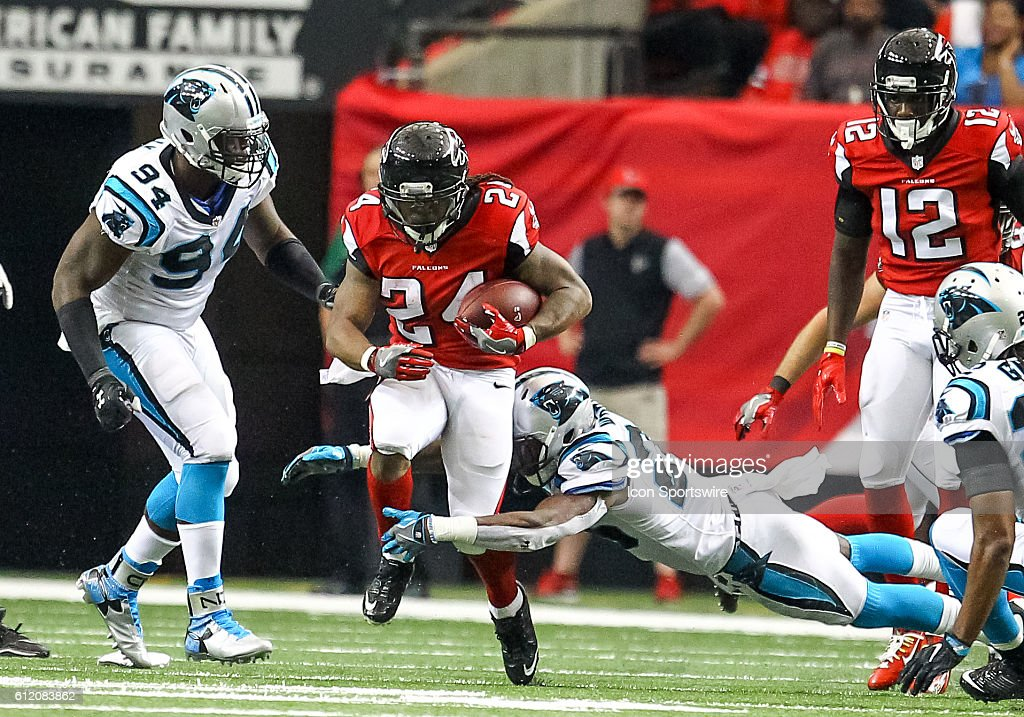 Atlanta Falcons running back Devonta Freeman (24) runs the ball for a first down during the fourth quarter of the NFL game between the Carolina Panthers and the Atlanta Falcons. The Falcons beat the Panthers 48 - 33 at the Georgia Dome in Atlanta, Georgia.
