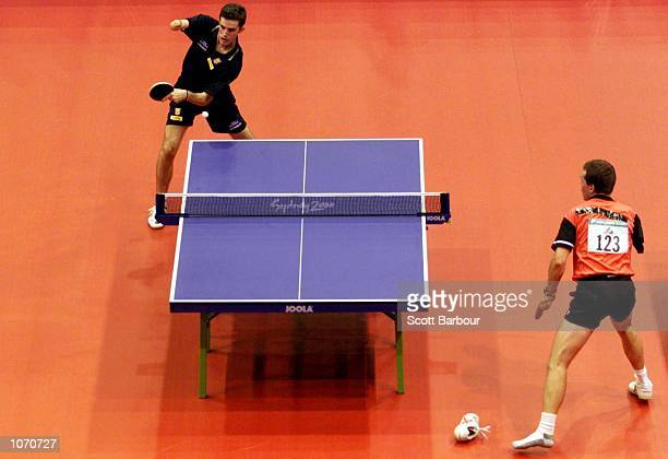 Jose Ruiz of Spain loses a shoe during his table tennis singles match against Martin Pelletier of Canada during the Sydney 2000 Paralympic Games at...