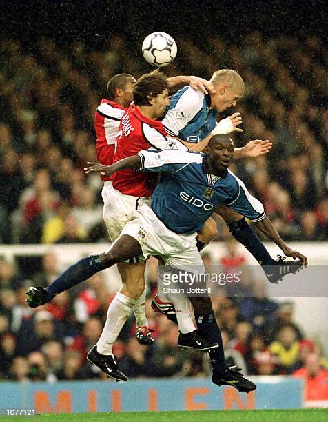 Ashley Cole of Arsenal Tony Adams of Arsenal Alf Inge Haaland of Manchester City and Shaun Goater of Manchester City go up for the ball during the...