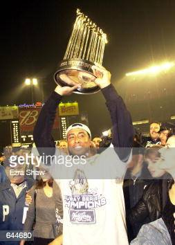 Bernie Williams of the New York Yankees celebrates the 42 win and World Series Championship over the New York Mets in five games during the World...