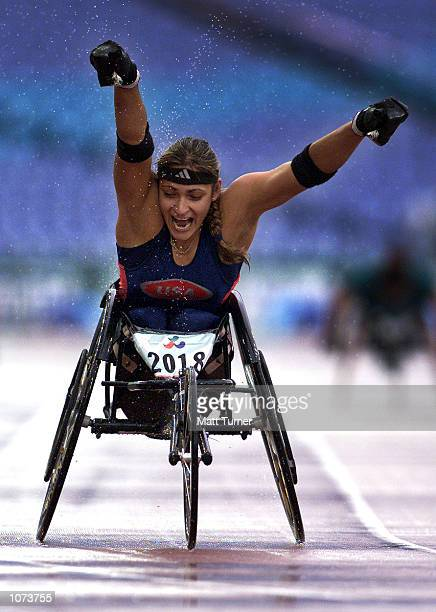 Cheri Becerra of USA celebrates winning the Gold medal in the Womens 400 metres T54 final at Stadium Australia during the Sydney 2000 Paralympic...