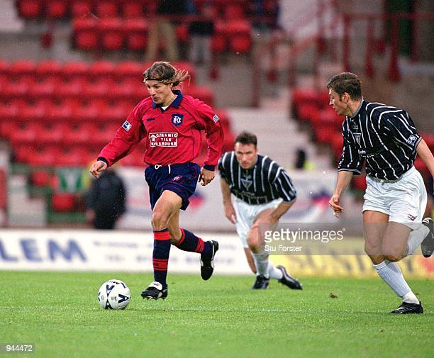 Claudio Caniggia of Dundee takes on the Dunfermline Athletic defence during the Scottish Premier League match played at East End Road in Dunfermline...