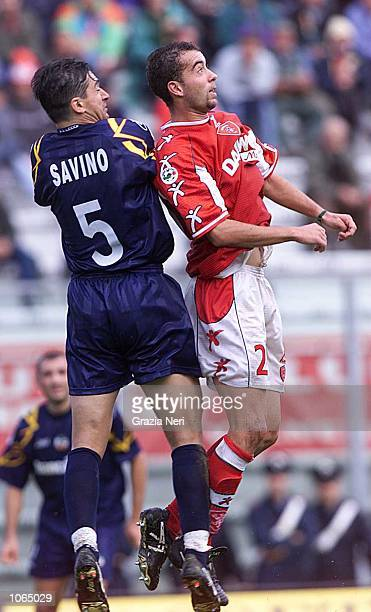 Cristian Bucchi of Perugia and Alberto Savino of Lecce challenge for the ball during the Serie A league match between Perugia and Lecce played at the...