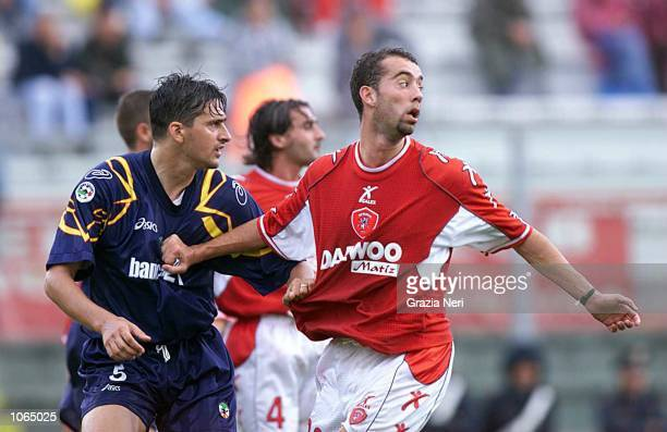 Cristian Bucchi of Perugia and Alberto Savino of Lecce hold each others shirts during the Serie A league match between Perugia and Lecce played at...