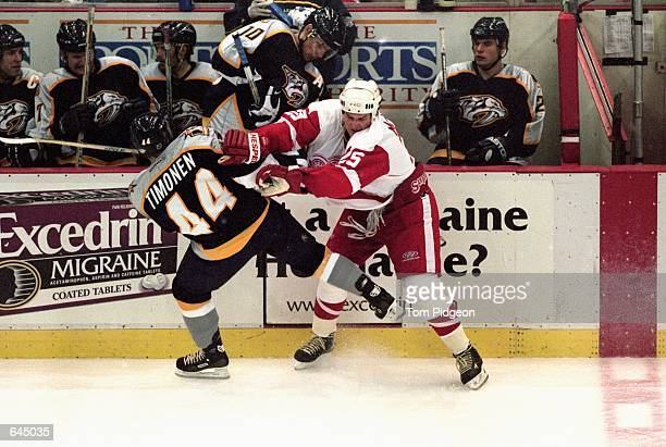 Darren McCarty of the Detroit Red Wings knocks over Kimmo Timonen of the Nashville Predators at the Joe Louis Arena in Detroit Michigan The Predators...