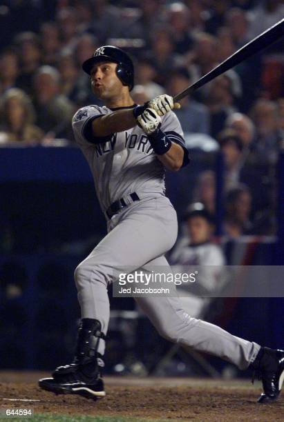 Derek Jeter of the New York Yankees watches his home run in the sixth inning against the New York Mets during Game 5 of the World Series at Shea...