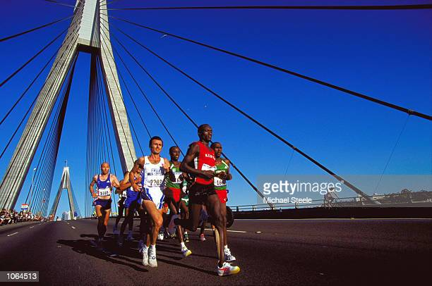Eric Wainaina of Kenya and Giacomo Leone of Italy lead the Pack across the Anzac Bridge in the Mens Marathon on day 16 of the Sydney 2000 Olympic...