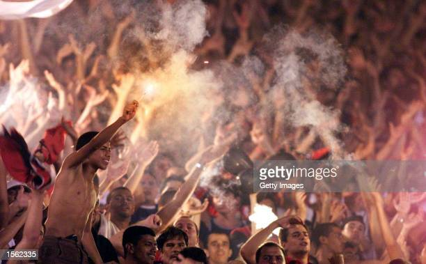 Flamengo fans let off flares in the stands during the Flamengo v Vasco de Gama Joao Havelange Cup match played at the Maracana Stadium Rio de Janeiro...