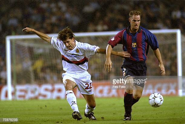 Frank De Boer of Barcelona and Vicente of Mallorca in action during the Spanish Primera League match between Barcelona and Mallorca in Barcelona...