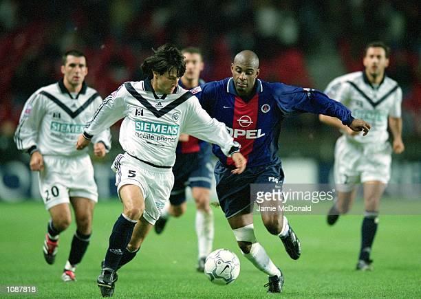 Jerome Bonnissel of Bordeaux is chased by Christian of Paris St Germain during the Championnat de France match at the Parc des Princes in Paris...