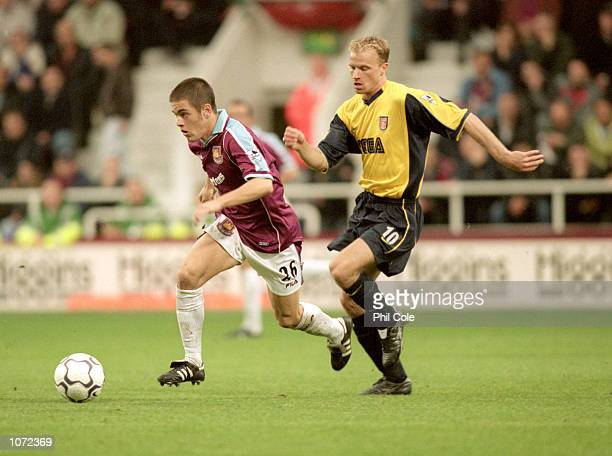 Joe Cole of West Ham beats Dennis Bergkamp of Arsenal during the FA Carling Premiership match played at Upton Park in London Arsenal won the match 21...