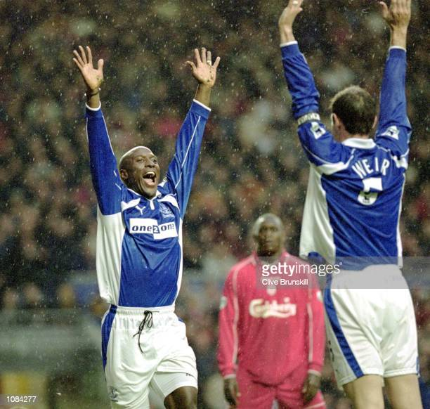 Kevin Campbell and David Weir of Everton celebrate during the FA Carling Premiership match against Liverpool played at Anfield in Liverpool England...