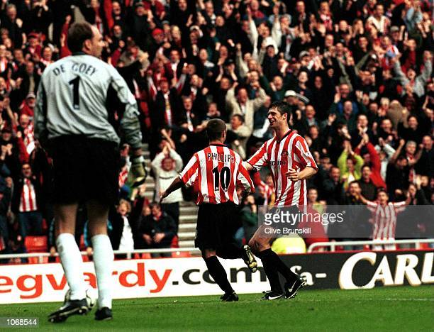 Kevin Phillips of Sunderland is congratulated by team mate Niall Quinn during the FA Carling Premiership match between Sunderland and Chelsea played...