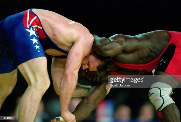Linclon Mc Ilravy of the USA tries to flip Daniel Igali of Canada during the Men's Freestyle Wrestling 69kg Event at the Sydney Exhibition Hall for...