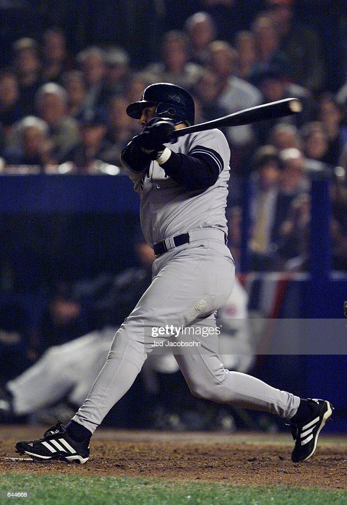 Luis Sojo of the New York Yankees hits the game winning single in the ninth inning against the New York Mets during Game 5 of the World Series at Shea Stadium in Flushing, New York. <DIGITAL IMAGE> Mandatory Credit: Jed Jacobsohn/ALLSPORT
