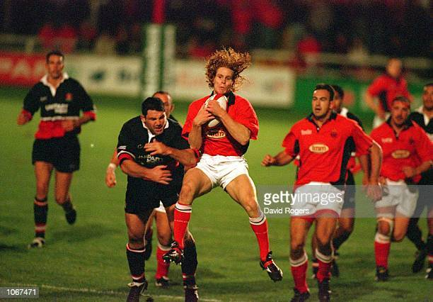 Matt Cardey of Llanelli takes a catch during the Heineken Cup Pool Match against Gloucester at Stradey Park in Llanelli Wales Mandatory Credit Dave...