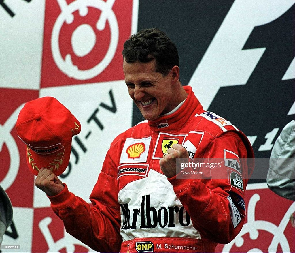<a gi-track='captionPersonalityLinkClicked' href=/galleries/search?phrase=Michael+Schumacher&family=editorial&specificpeople=157602 ng-click='$event.stopPropagation()'>Michael Schumacher</a> of Germany and Ferrari celebrates after winning the formula one world championship at the Japanese Grand Prix at Suzuka, Japan. Mandatory Credit: Clive Mason/ALLSPORT