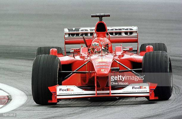 Michael Schumacher of Germany and Ferrari in action during the second free practice session for the Malaysian Formula One Grand Prix at the Sepang...
