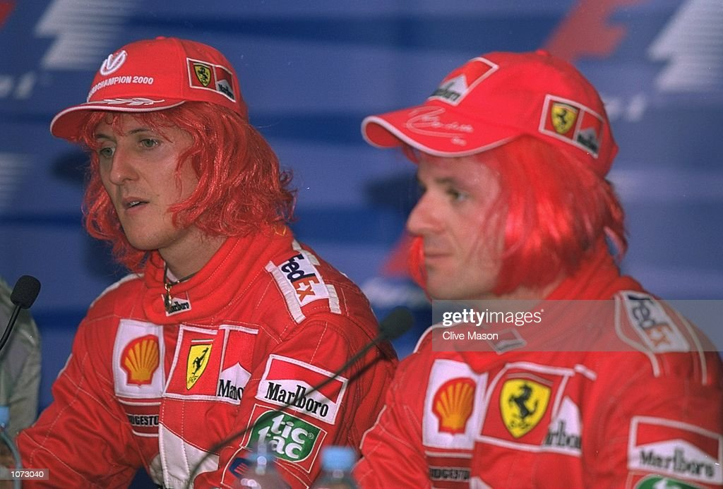 Michael Schumacher (left) of Germany and Ferrari with Rubens Barrichello (right) of Brazil and Ferrari celebrate by wearing Ferrari red wigs after the Malaysian Formula One Grand Prix at the Sepang Circuit, in Kuala Lumpur, Malaysia. \ Mandatory Credit: Clive Mason /Allsport