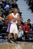 Muggsy Bogues of the Toronto Raptors moves with the ball during the game against the Detroit Pistons at the Air Canada Center in Toronto Canada The...
