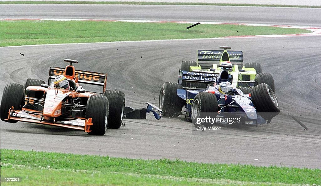 Pedro De La Rosa of Arrows and Nick Heidfeld of Prost collide at the Malaysian Formula One Grand Prix at the Sepang circuit,Kuala Lumpur, Malaysia. Mandatory Credit: Clive Mason/ALLSPORT