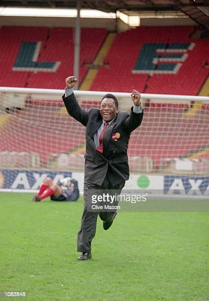 Pele celebrates after scoring past Gordon Banks during an AXA photocall at Wembley in London Mandatory Credit Clive Mason /Allsport