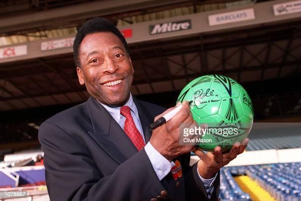 Pele signs the NSPCC Ball during the AXA Sponsored Photocall held at Wembley Stadium London Mandatory Credit Clive Mason/ALLSPORT