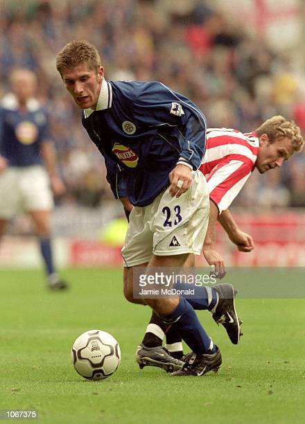 Richard Cresswell of Leicester City spins past Michael Gray of Sunderland during the FA Carling Premiership match at the Stadium of Light in...