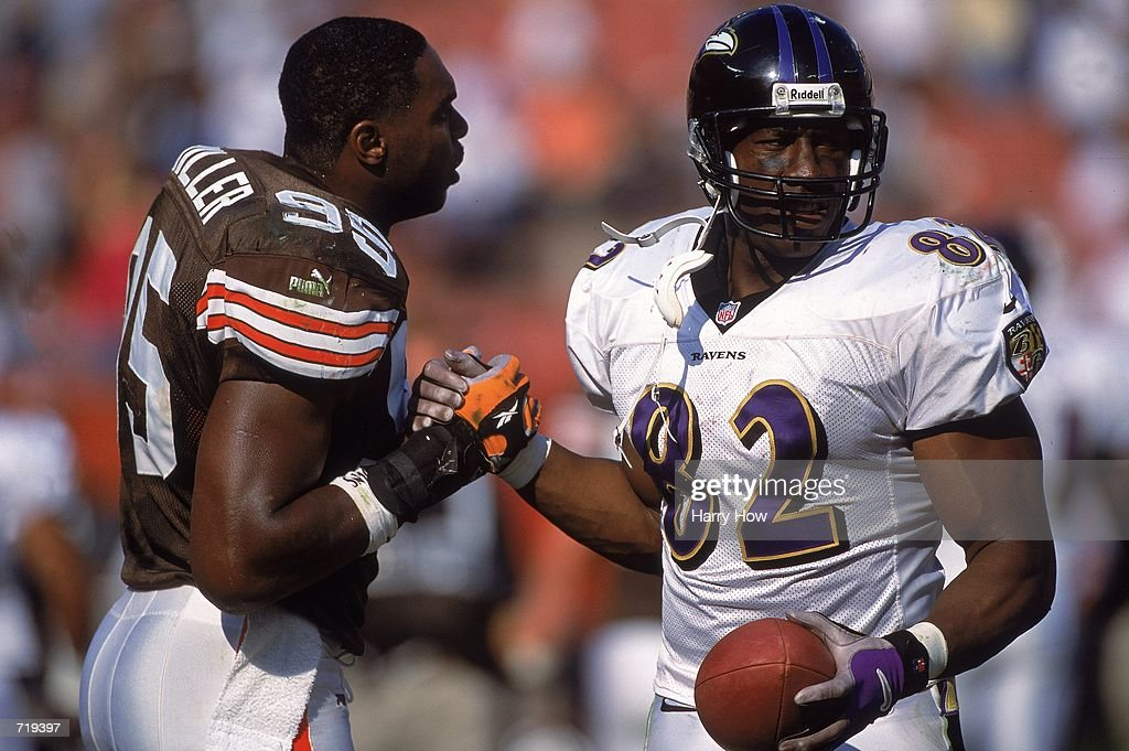 836fed08dca ... Shannon Sharpe 82 of the Baltimore Ravens gets a helping hand from  Jamir Miller ...