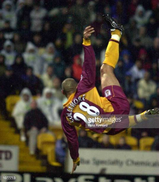 Stan Collymore of Bradflord jumps to score during the Bradford City v Leeds United FA Carling Premiership match the Valley Parade ground Bradford...