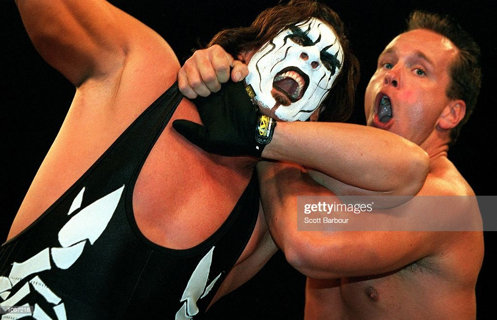 Sting is held by Mike Sanders during their bout at the World Chamionship Wrestling ''Thunder Down Under'' night at the Sydney Entertainment Centre...