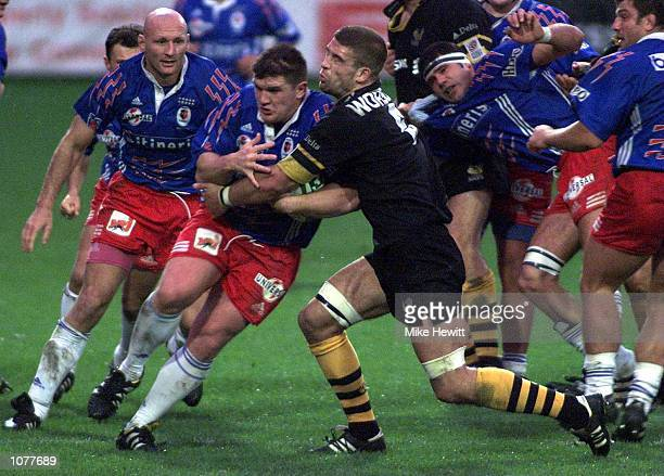 Sylvain Marconnet of Stade Francais is stopped by Joes Worsley of Wasps during the match between Wasps and Stade Francais in the Heineken Cup Pool...