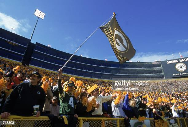 The Green Bay Packers fans cheer and wave a big banner during a game against the San Francisco 49ers at Lambeau Field in Green Bay Wisconsin The...