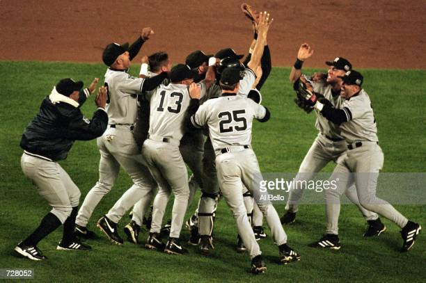 The New York Yankees celebrate their World Series clinching victory in Game 5 of the World Series at Shea Stadium in Flushing New York The Yankees...
