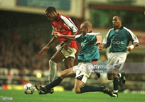 Thierry Henry of Arsenal beats Spencer Prior of City to go on and score during the match between Arsenal v Manchester City in the FA Carling...
