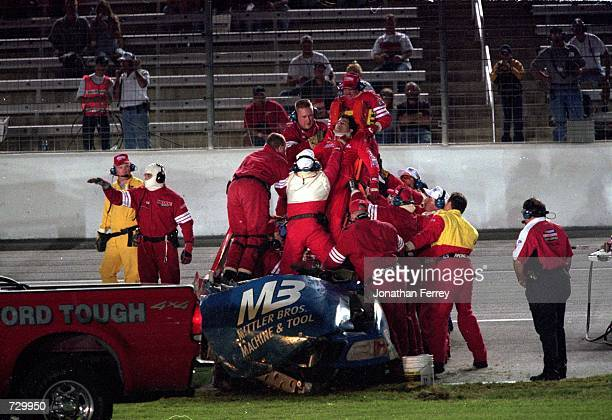 Tony Roper gets pulled from the werckage during the O''Reilly 400 part of the NASCAR Craftsman Truck Series at the Texas Motorspeedwaqy in Ft Worth...