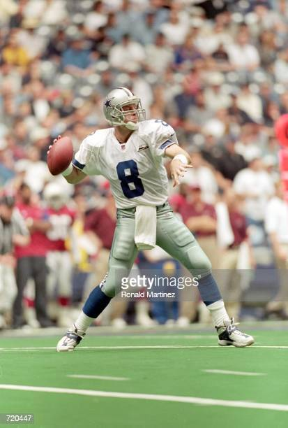 Troy Aikman of the Dallas Cowboys drops back to pass the ball during the game against the Arizona Cardinals at the Texas Stadium in Irving Texas The...