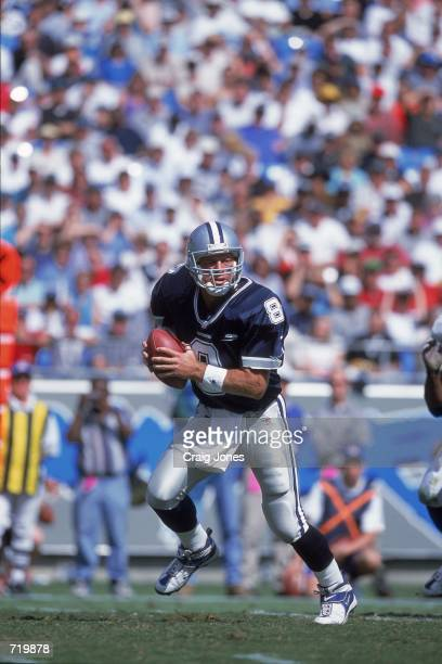 Troy Aikman of the Dallas Cowboys moves to pass the ball during the game against the Carolina Panthers at the Ericsson Stadium in Charlotte North...