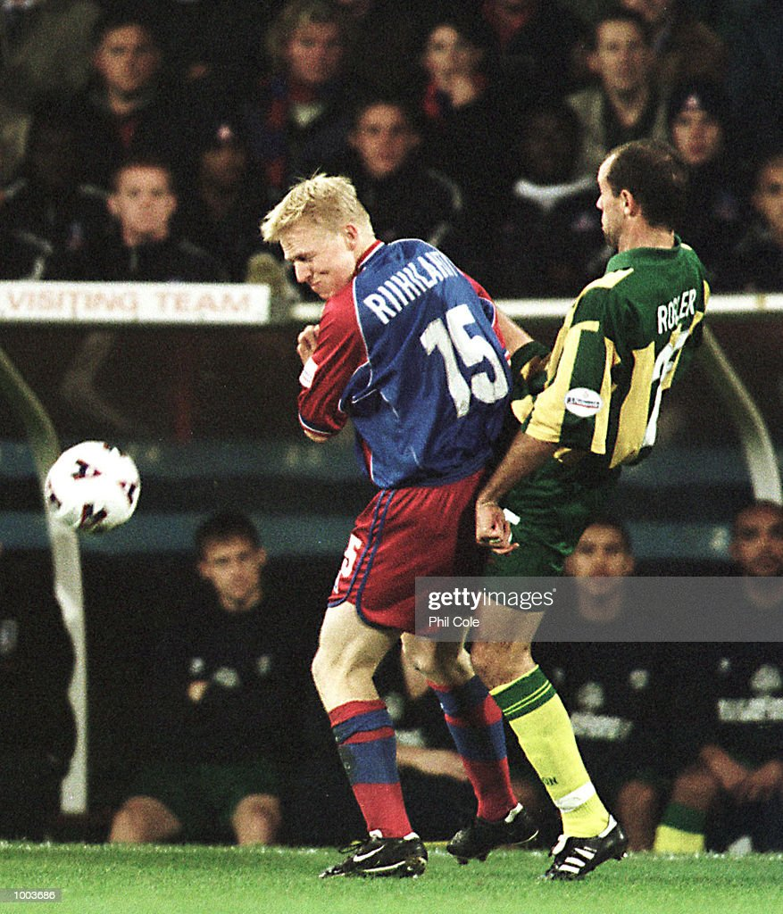 Aki Riihilahti of Crystal Palace is tackled by Uwe Rosler of WBA during the Nationwide Division One match between Crystal Palace FC and West Bromwich Albion at Selhurst Park, London. Mandatory Credit: Phil Cole/ALLSPORT