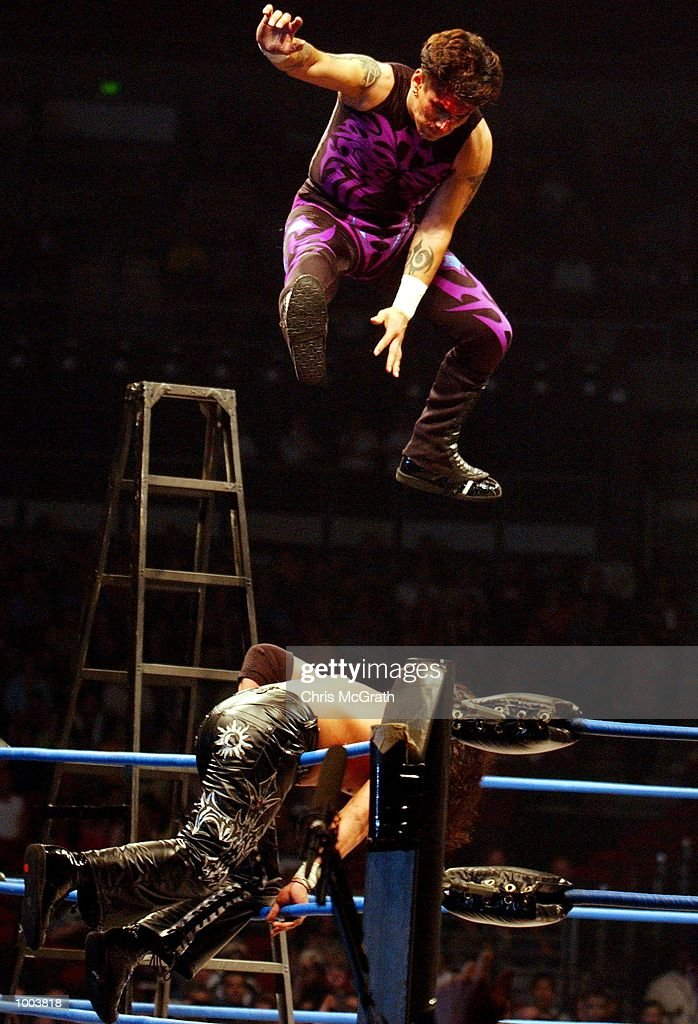 An unnamed fighter launches from a ladder on to Juventud Guererra during the WWA Wrestling 'Inception' fight night held at the Sydney Superdome, Sydney, Australia. DIGITAL IMAGE Mandatory Credit: Chris McGrath/ALLSPORT