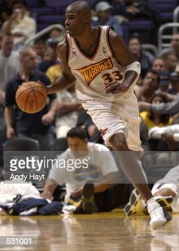 Antawn Jamison of the Golden State Warriors brings the ball downcourt against the Phoenix Suns during preseason action at Staples Center in Los...