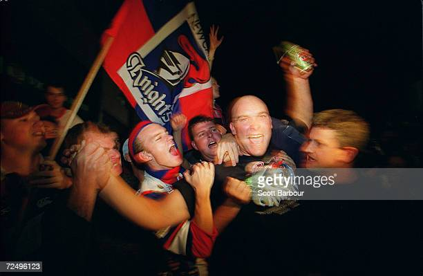 Ben Kennedy of the Knights celebrates with the fans after the Knights arrive at Marathon Stadium to celebrate after the Newcastle Knights won the NRL...