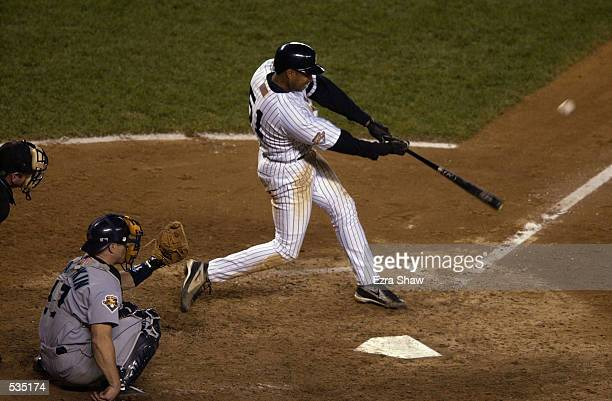 Bernie Williams of the New York Yankees hits against the Seattle Mariners during the American League Championship Game at Yankee Stadium in the Bronx...